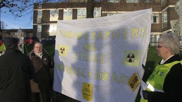 NHS workers take strike action