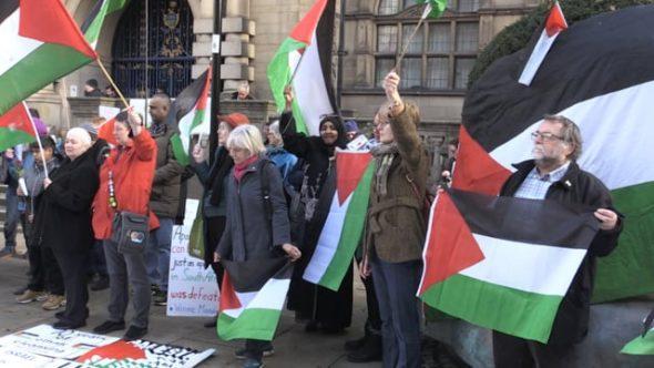 Dozens join Palestine solidarity protest